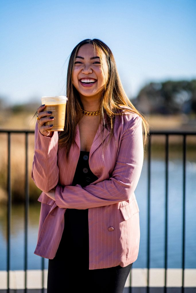 Jenn Hanft CEO and Founder of JOUHCO smiling with nitro cold brew